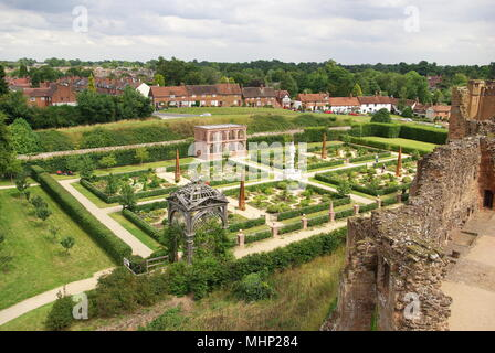 Aerial view of the Elizabethan garden at Kenilworth Castle, Warwickshire, showing the symmetrical layout, with ruins of a wall in the right foreground.     Date: circa 2010s - Stock Image