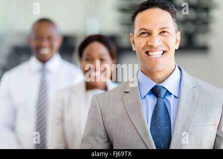 handsome businessman with business team on background - Stock Image