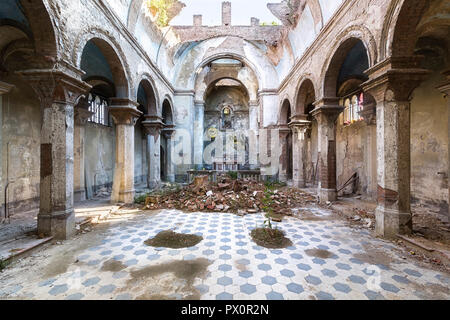 Interior view of an abandoned church in Italy. - Stock Image