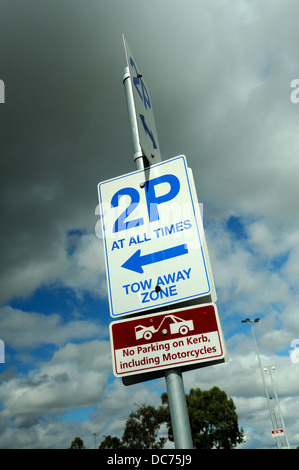 Sign indicating 2 hour parking limit and tow away zone. Perth, Western Australia - Stock Image