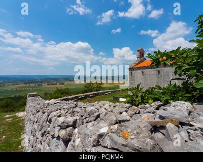 Holy Spirit Sveti Duh church chapel near Susnjevica in Croatia field Cepic in background - Stock Image