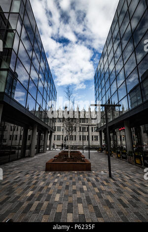 Marischal College reflecting off the modern Marischal Square, showcasing old and new architecture in harmony - Stock Image