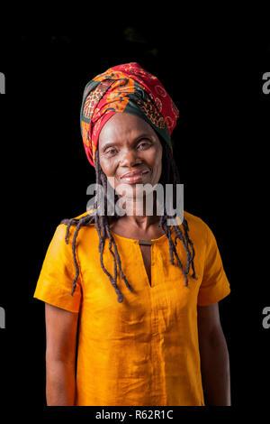Portrait of an elderly African woman wearing a headscarf - Stock Image