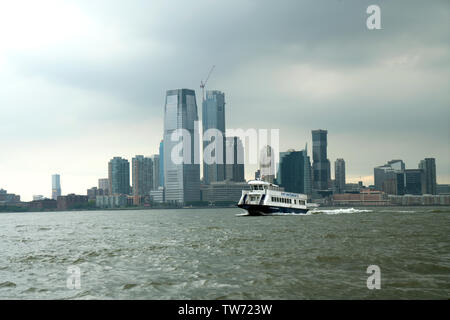 On a cloudy day, a New York Waterway ferry sped across the Hudson River from New Jersey, heading toward Manhattan. June 17, 2019 - Stock Image