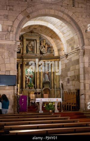 Spain, Galicia, A Coruna, Old Town, Iglesia de Santiago, interior, carved stone arch above altar - Stock Image