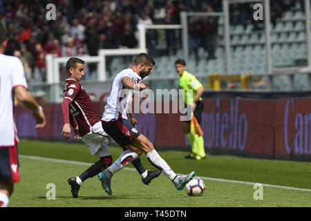Turin, Italy. 14th Apr, 2019.  Serie A football, Torino versus Cagliari; Alex Berenguer of Torino FC challenges Paolo Farago of Cagliari Credit: Action Plus Sports Images/Alamy Live News - Stock Image