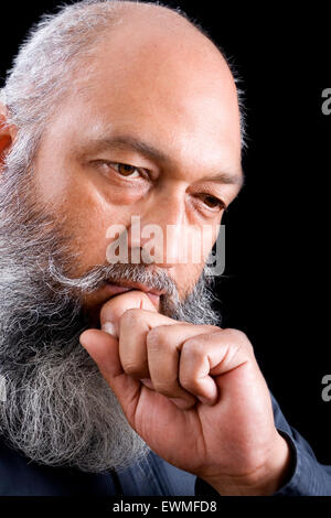 Stock image of bearded man over dark background - Stock Image
