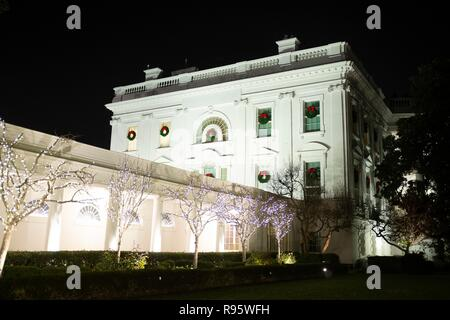 The White House decorated for Christmas and lighted at night December 12, 2018 in Washington, DC. - Stock Image