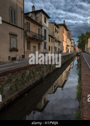 Canal that used to be the old moat in the city of Lucca, Tuscany, Italy - Stock Image