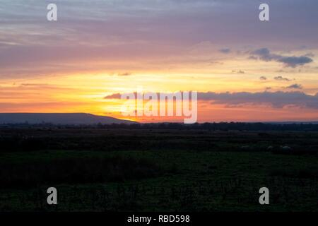Pevensey Levels, East Sussex,UK. 9th Jan, 2019. UK weather. Sunset over the Pevensey Levels in East Sussex this evening after another cold day. Pevensey Levels, East Sussex,East Sussex, UK. Credit: Ed Brown/Alamy Live News - Stock Image