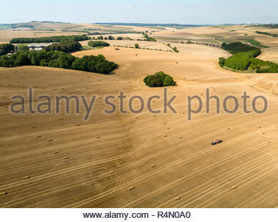 Aerial landscape of harvested summer farm wheat and barley fields and straw bales - Stock Image