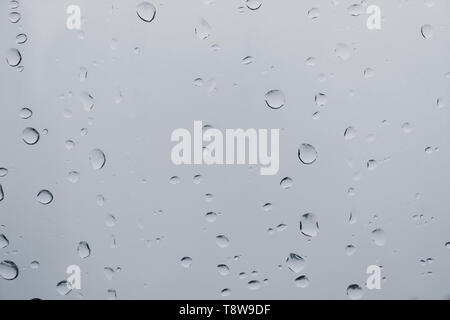 Drops of water on a window pane - Stock Image