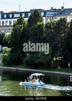 Strasbourg, Alsace, France, sightseeing tourists, small electric boat, river cruise, Ill river, residential buildings, - Stock Image