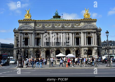 Opera Garnier, Paris, France. August 2018. Period movie filmmaking. Palais Garnier. Sunny day, blue sky with clouds. - Stock Image