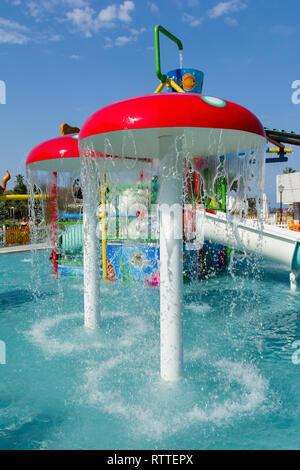 KUSADASI, TURKEY - AUGUST 21, 2017: Colourful plastic slides in aquapark. Children water playground. - Stock Image