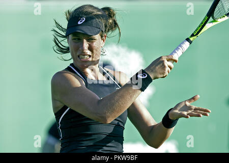 Johanna Konta plays a shot during a match at a grass court tournament in 2018. Jo Konta in action, professional women's tennis, close-up. - Stock Image