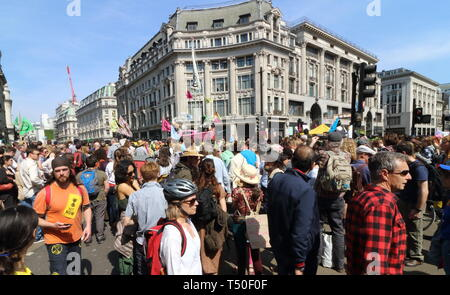 London, UK. 19th Apr, 2019. Oxford Circus seen blocked by protesters and member of the public on a busy Easter Bank Holiday during the demonstration.Environmental activists from Extinction Rebellion movement occupy London's Oxford Circus for a 5th day. Activists parked a pink boat in the middle of the busy Oxford Circus road junction blocking the streets and causing traffic chaos. Credit: Keith Mayhew/SOPA Images/ZUMA Wire/Alamy Live News - Stock Image