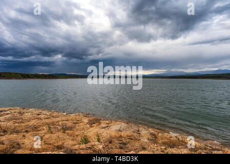 Lake with storm rainy clouds - Stock Image