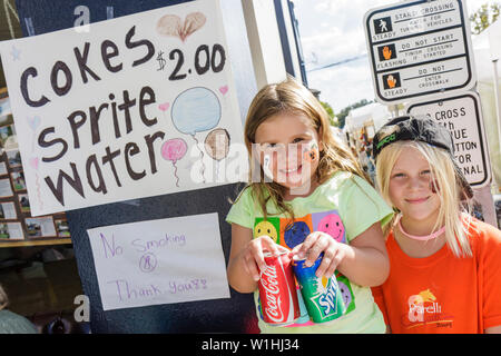 Mount Dora Florida Mt. Annual Craft Fair event community festival vendor young entrepreneur girl sister child student Coke water - Stock Image