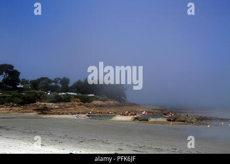 View of mist coming in from the sea from Promenade de Penarth, Vrennit, Saint Pol de Leon, Finistere, Brittany, France - Stock Image