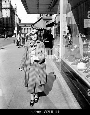 Street scene, Washington, D.C., woman walking down sidewalk ca. 1936 - Stock Image