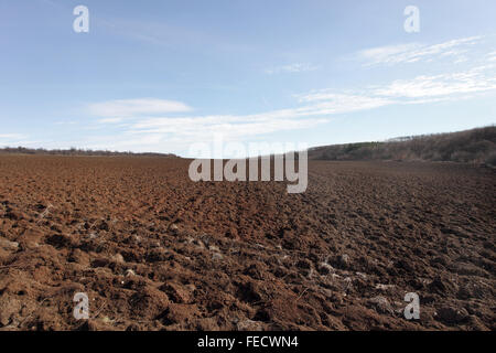 Plowed field before planting. - Stock Image
