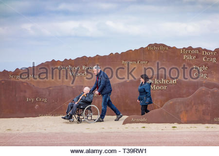 Profiles of the Lake District hills across Morecambe Bay, cut out in rusted iron and located on Morecambe Promenade, Lancashire, England, UK - Stock Image