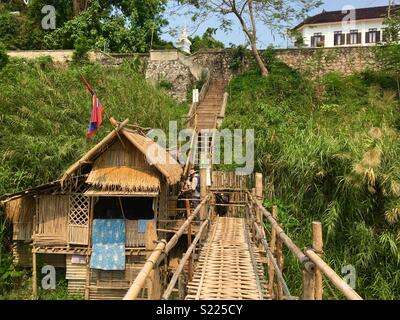 Bamboo bridge in Luang Prabang Laos with hut to take payment for crossing - Stock Image