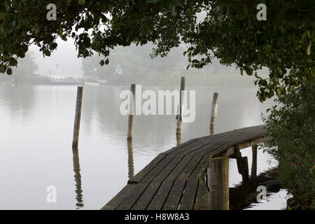misty morning on the wooden pier - Stock Image