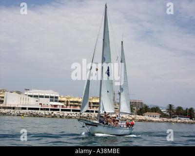 Yacht Sailing in the Mediterranean Sea off the coast of Benalmadena Costa del Sol Spain  yacht yachts sail sails full sailing - Stock Image