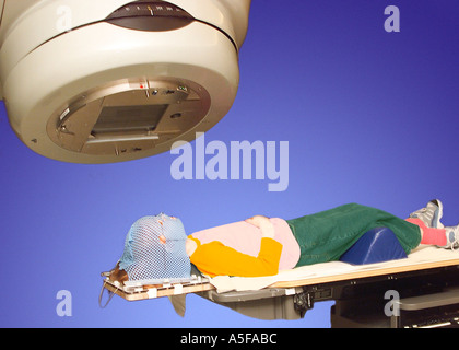 A Child receiving MRI treatment for cancer - Stock Image