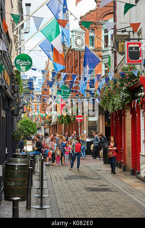 A street in Temple Bar, Dublin with buildings decked in bunting - Stock Image
