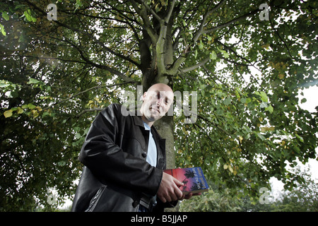 Author Christopher Brookmyre with his favourite book Lord of the Flies - Stock Image