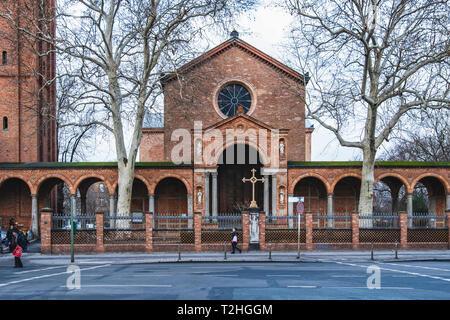 Berlin Alt-Moabit. Saint John the Baptist Protestant church exterior & façade. Brick Italian Romanesque style hall by Schinkel 1832-35, Campanile by S - Stock Image