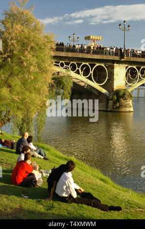 Holy Week. Procession of the brotherhood of El Cachorro, crossing the Triana bridge over the river Guadalquivir. Seville. Region of Andalusia. Spain.  - Stock Image