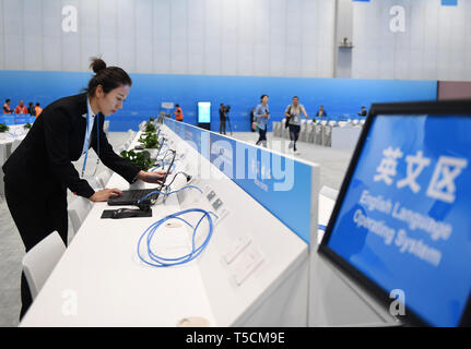 (190423) -- BEIJING, April 23, 2019 (Xinhua) -- A staff member prepares a laptop at the Media Working Area of the Media Center for the second Belt and Road Forum for International Cooperation in Beijing, capital of China, on April 23, 2019. The media center started trial operation at the China National Convention Center in Beijing Tuesday. More than 4,100 journalists, including 1,600 from overseas, have registered to cover the second Belt and Road Forum for International Cooperation to be held from April 25 to 27 in Beijing. (Xinhua/Zhang Chenlin) - Stock Image