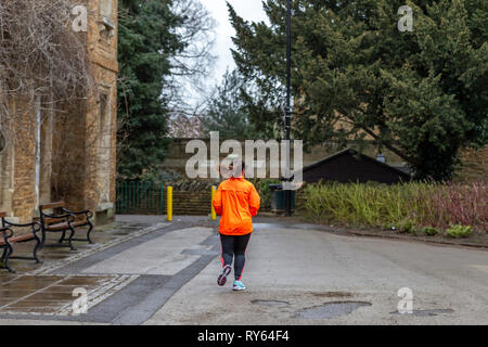 Northampton. U.K. 12th March 2019. Abington Park. People out exercising this morning as Storm Gareth is expected to hit the UK later on today, bringing gale force winds and torrential rain. Credit: Keith J Smith./Alamy Live News - Stock Image
