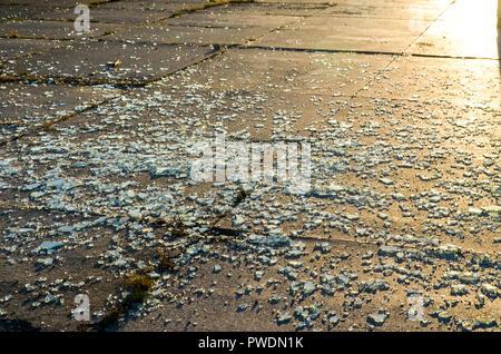 Broken glass with sunset light - Stock Image