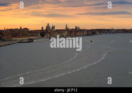 Early morning view of the Venetian skyline, Venice, Italy with the San Basilio Cruise Terminal in the foreground - Stock Image
