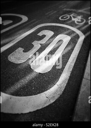 A 30 zone within an urban environment- the speed limit is clearly visible. An image with many potential uses. Photo Credit © COLIN HOSKINS. - Stock Image
