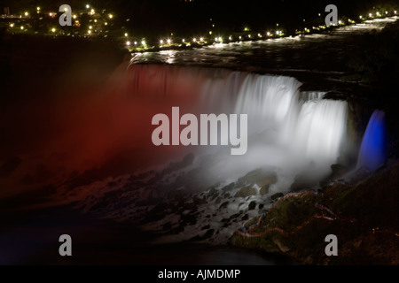 American Falls and Bridal Veil Falls lit up at night in patriotic red white and blue - Stock Image