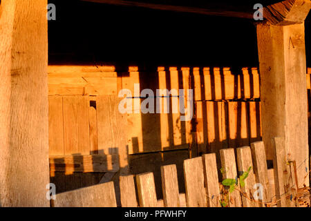 setting sun casts a golden light onto a broken down derelict pig sty in zala county hungary - Stock Image