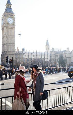 UK, London, two women in the city near Big Ben - Stock Image