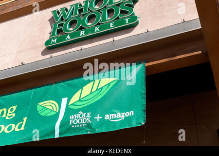 Amazon and Whole Foods sign on Cupertino Whole Foods store - Stock Image