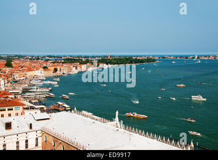 View east from St Marks Bell Tower Venice Italy showing roof of Doges Palace and Canale di San Marco with I Giardini - Stock Image
