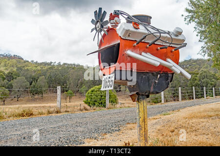 Roadside Mail Box Styled from an oil drum as an V8 Engine. Southern Queensland Australia. - Stock Image