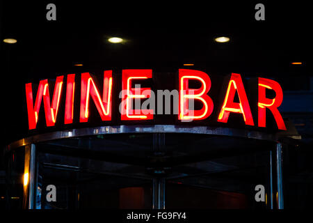Wine bar neon sign on a restaurant entrance - Stock Image