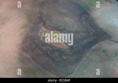 Patch of green in fields, aerial view, Andalucia, Spain - Stock Image