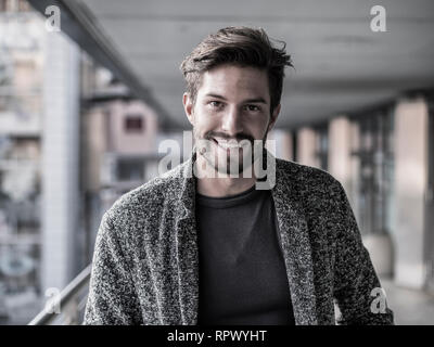 One handsome young man in city setting - Stock Image