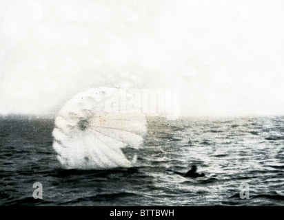 Parachutist Lands in the sea. - Stock Image